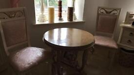 Table and swan chairs