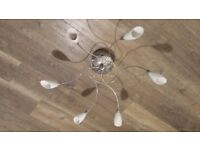 Central light fitting with halogen lights