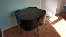 Dinning room table and chairs (space saver)