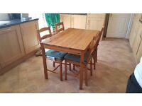 Pine table and 4 chairs.