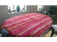 Velour throw or tablecloth in striped shades, overall colour red. 166x138cms