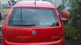 breaking fiat grande punto bright red four door all parts available