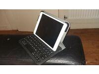 white ipad mini with keyboard case