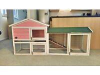 'Cozy Pets' rabbit hutch for sale.