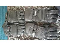 Two sets of leather motorbike gloves