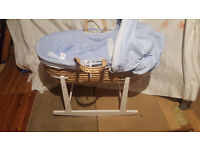 Blue and white moses basket comes with white rocking stand and spare covers