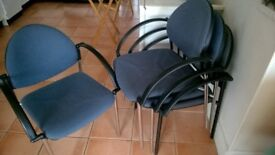 Four comfortable stacking chairs with arms