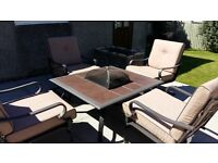 Garden table and chairs with fire pit/bbq/ice pit