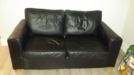 Black leather sofa bed. Few cat scratches on arms. Needs to go by weekend.
