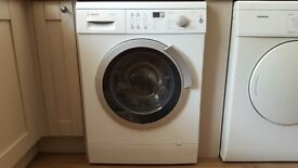 Family sized Bosch Maxx9 (9 Kg) washing machine - can be seen plumbed-in and working