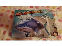 Air swimmer toy