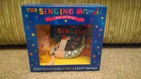 Brand new The singing mermaid book and toy set