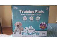 New & unopened box of puppy training pads
