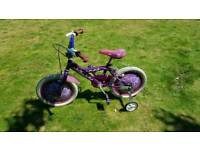 Girls bike with stabiliser