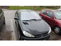 peugeot 206 cc 2.0 ltr Red and Black leather interior