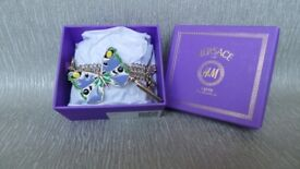 Gorgeous Charm Bracelet by Versace Exclusive for H&M. Brand new with tags