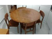Circular flap down table and four chairs