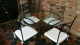 Circular Glass table and 4 chairs,