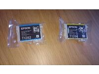 Epson printer cartridges. Brand new Sealed T1282 cyan and T1284 yellow