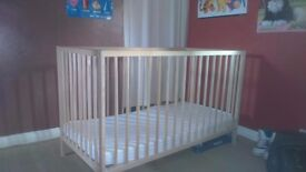 Cot with mattress and sheets