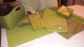 cushions, magazine basket, place mats, table runners all in green