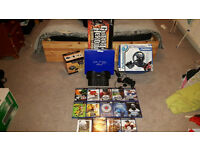 PS 2 with lots of accessories and 14 games (would suit a golf fanatic)