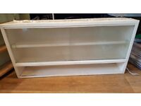 Retro shabby chic kitchen cupboard with glass doors