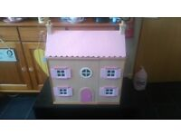 Small wooden dolls house