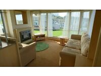 STATIC CARAVAN FOR SALE ON 12MTH HOLIDAY PARK. HEATED INDOOR POOL, SEA VIEWS, DOUBLE GLAZED, C H.