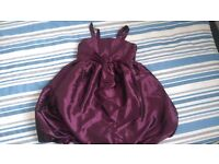 Age 7-8 two dresses party occassion wear one purple satin and one black with white polka dots