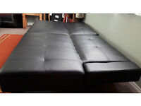 Sofa bed, black leather effect