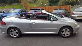 Silver Peugeot 307 CC convertible Great for summer months! Red and black leather interior