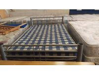 Silver metal double bed frame with mattress