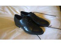 Black rockport leather shoes, size 4.5