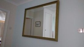 Large mirror, gold patterned wood frame.