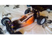 New condition Schumacher Cougar SV2 radio controlled car rc car with top end specs. Price reduced