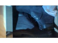Timberland black size 10 boots still in original box. Never been worn. Bought at Selfridges