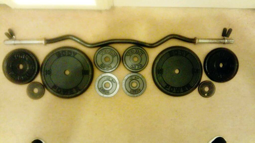 Ez bar and 38.5kg of metal weight plates