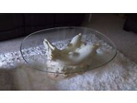 Glass coffee table with dolphin base
