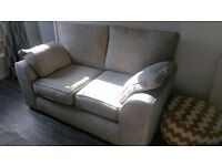 Large 2 seater sofa in grey with arm pillows that are removable so easy to wash.