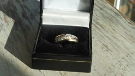 9ct yellow gold 375 and diamond cross over ring 0.25 carat fully hallmarked