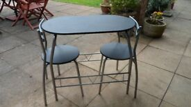 Compact Dining Table and Two Chairs in Very Good Condition