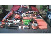 14 Nerf guns + attachments + darts