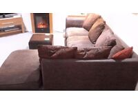 chocolate coloured corner sofa with faux leather arm and base.cushions included.