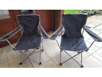 Two camping or festival chairs with carry bags