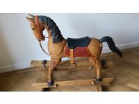 Wooden Rocking Horse very good condition.