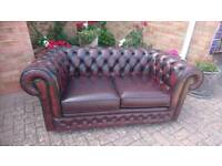 A Thomas Lloyd ox blood red leather Chesterfield 2 seater sofa