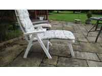 Short or long adjustable white plastic garden chair with cushion and side table.