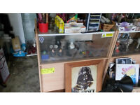 2 wooden shop display counters. large one is approx 37 inches x 21 smaller is approx 49 x 21