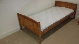 single bed complete with mattress and protector